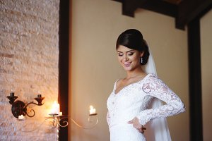 Beautiful bride is wearing a wedding