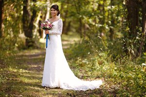 Bride in a wedding white dress with