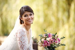 Beauty portrait of bride wearing fas