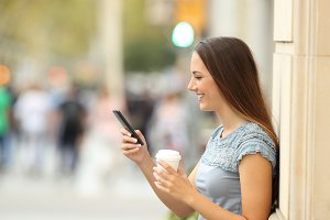Side view of a girl using a phone