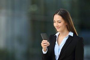 Single executive woman checking cell