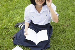Schoolgirl was reading and homework.