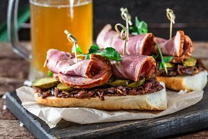 Sandwiches with smoked meat, onion jam and mug of beer