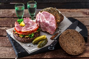 Rye burger with smoked ham, pickles and two glasses of vodka