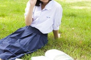 Schoolgirl smiling and sitting