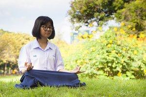 Schoolgirl was meditating.