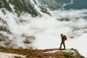 Hiker traveling in mountains