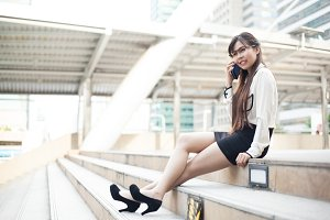 Businesswoman talking phone.