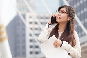 Asian business woman talking