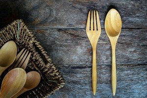 Wooden Spoon and fork on grunge text