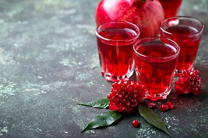 Glasses of fresh pomegranate juice.