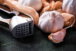 Fresh garlic on green background