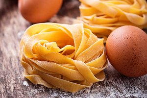 Raw pasta tagliatelle and eggs