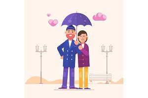 Loving couple under an umbrella.Happy family portrait isolated on white background. Valentines Day
