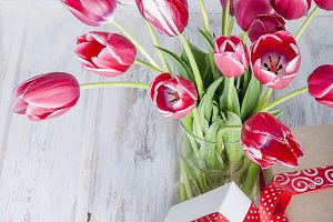 Bouquet of pink tulips in a glass va