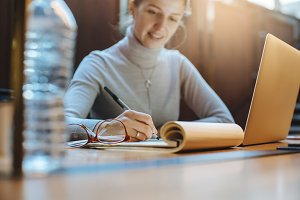 Positive female freelance working