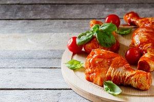 chicken legs in red sauce