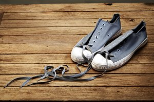 shoe gray color with love on wooden
