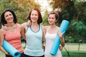 Women holding fitness mat