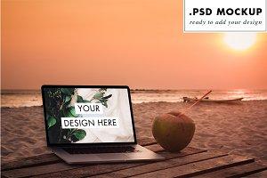 PSD laptop sunset beach