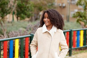 Pretty girl with afro hair in a park