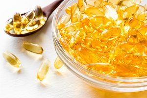 fish oil in a glass cup