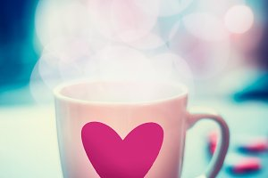 Romantic mug and heart at bokeh