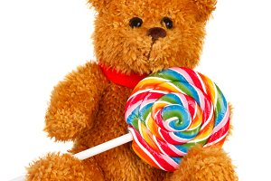 Brown teddy bear with a candy