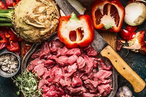 Raw gut meat with kitchen knife