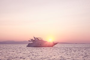 Couples on yacht at sunset