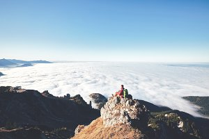 Hiker above clouds
