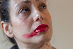 Smudged red lipstick