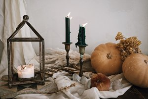 Still life with candles and pumpkin