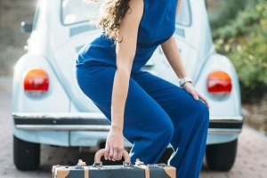 beautiful woman with suitcase and ca