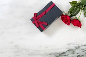 Wrapped Gift box and Red Roses