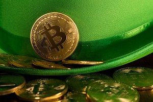 Pile of bitcoins inside green hat St Patricks Day