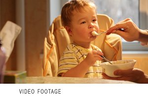 Little boy eats porridge. Time lapse