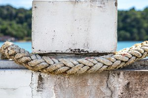 white rope closeup, tied to the pier