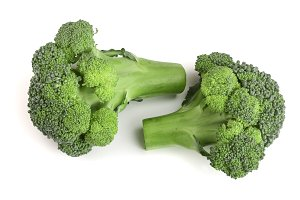 fresh broccoli isolated on white background close-up. Top view