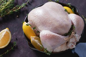 Raw chicken whole with lemon