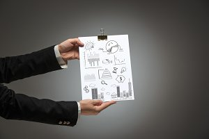 Male hands holding business plan