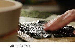 Putting wasabi on the nori while
