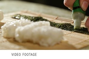 Putting wasabi on the nori