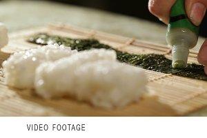 Putting wasabi on the nori