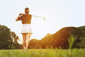 Woman golf player swing shot