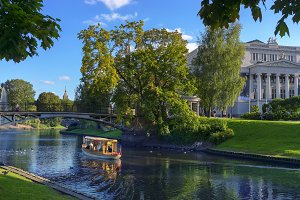 A boat with tourists on the canal of Riga