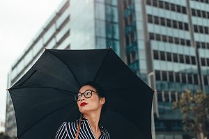 Asian businesswoman on city street