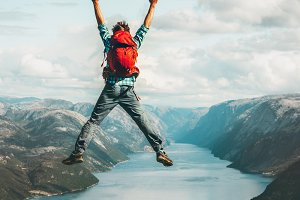 Happy Man jumping above Lysefjord