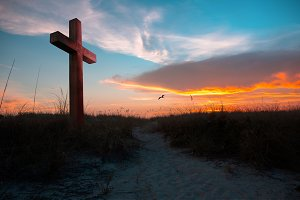 Sunset illuminating a cross