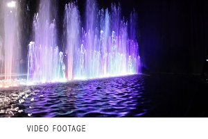 Colorful fountain and water surface.